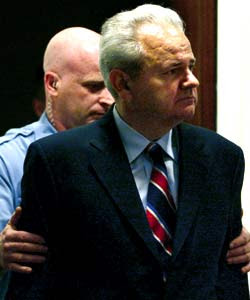 Slobodan Milosevic Escorted by Police at ICTY